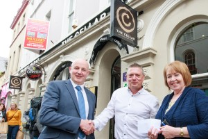 Owner of the Cellar Bar & Restaurant on Eglinton St. Michael Gilmore prsenting cheque of €1200 to Eileen Kelly Services Manager and Pat Holmes CEO  at Western Alzheimer Galway