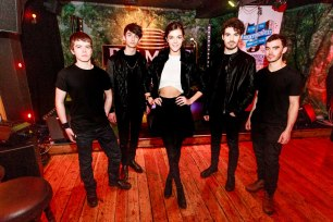 Model Racheal Carroll with the members of D-Day Keith Whyte, Chris Breslin, Darragh Whyte lead singer and songwriter and Cathal Sweeney at the launch of the Rocktoberfest 2015 in Monroe's Live