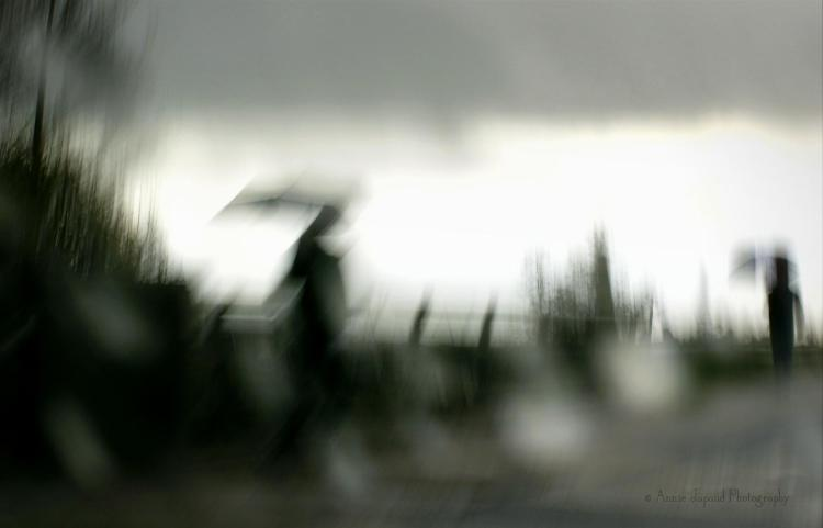 blurred image of silhouettes in the wind and rain