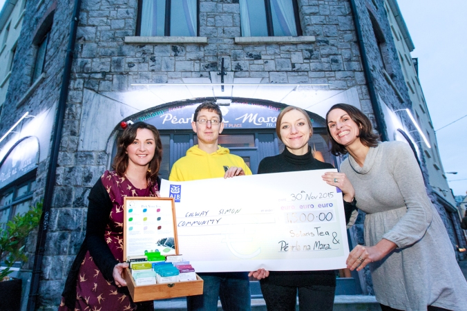 Aaron Turner of Galway Simon receiving a cheque from Pearla na Mara's owner Justyna Kocjan and Karin Mueller representing Solaris Tea. €1500.00 was for Galway Simon founded on evening with Aindrias de Staic, My Fellow Sponges and Solaris blended by Master Blender Jörg Müller. Photo by Darius Ivan
