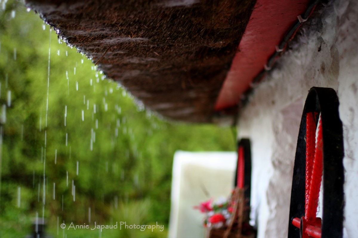 rain falling from thatched roof