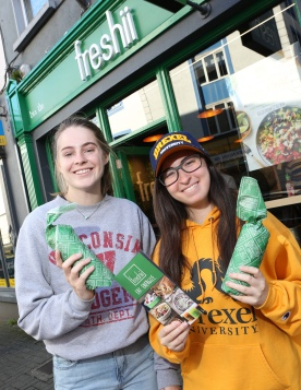 To celebrate the opening of Freshii in Galway, the global healthy fast food restaurant chain invited Galwegians to Eat and Energize for FREE on Thursday. Pictured are Katie Kowski and Emily Gerberman. Photograph by Aengus McMahon